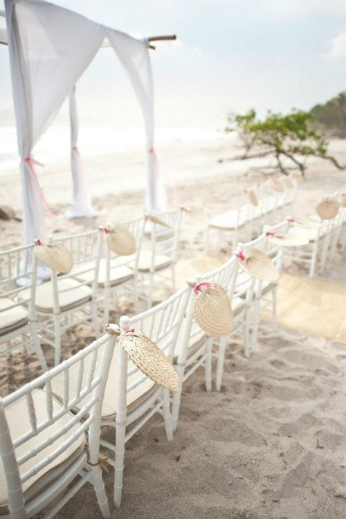 I Like The Way These Are Displayed Since They Add To Ceremony Decor And Spruce Up Those Plain White Chairs Beach Wedding