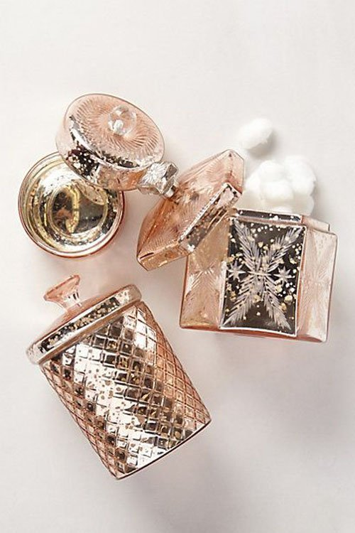 Accents in pink metallic (like these bathroom accessories from Anthropologie) make for unexpected vases on your reception tables.