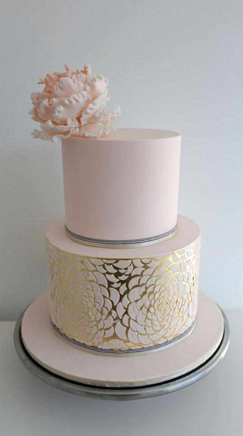 The soft metallic and pink colors of this wedding cake would be a gorgeous addition to any wedding theme.