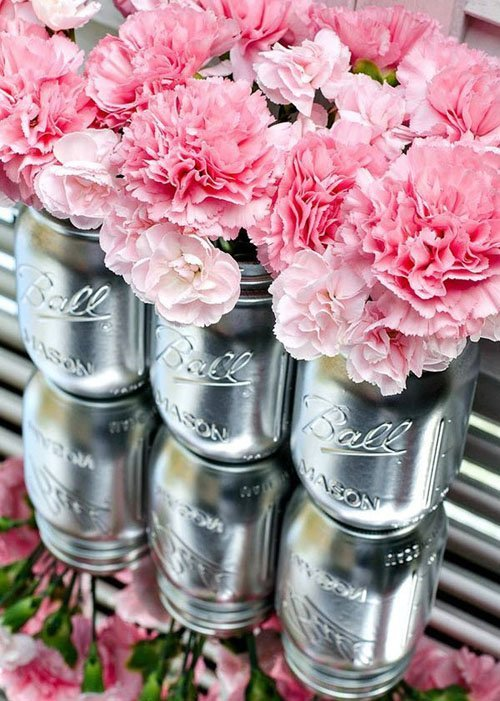 Pair different tones of pink flowers in metallic mason jars for a major pop of color.