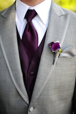 Match your groom's boutonniere to his tie to bring your color palette front and center.