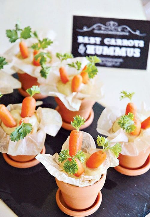 baby carrots and hummus in pot