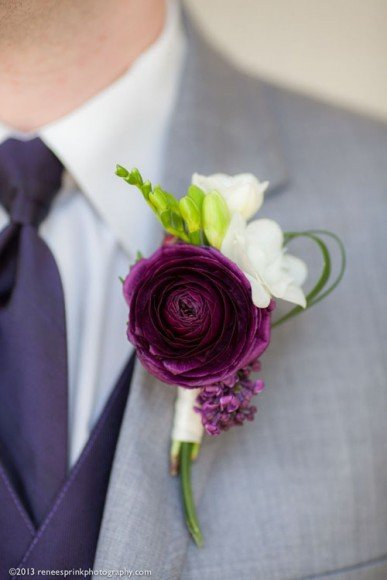 This deep purple boutonniere is perfect for a spring wedding.