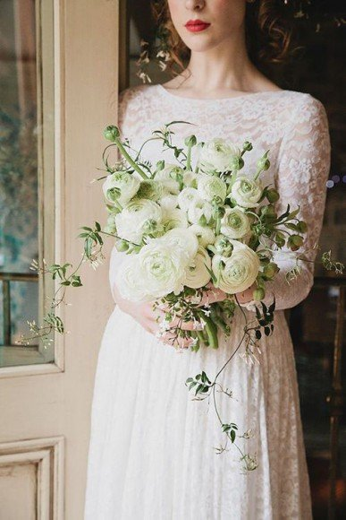 You cannot go wrong with an all white wedding bouquet. Photo  by Eve Photography