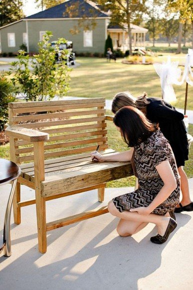 Have guests sign a bench that you can put in your new backyard. Via