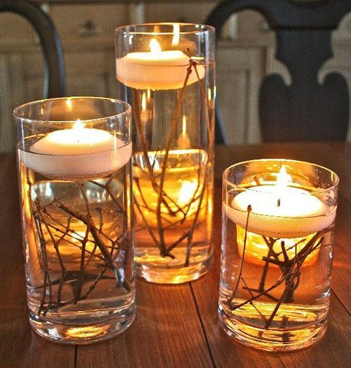 Looking for an inexpensive centerpiece? Branches make a big visual impact when placed in water with floating candles.