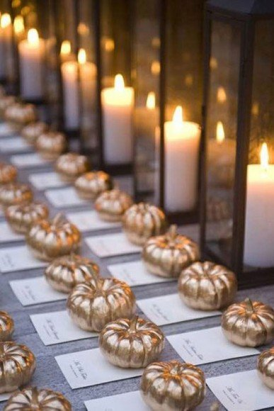 I love spray painting pumpkins for an elegant look. These are perfect for place cards or escort cards. Via