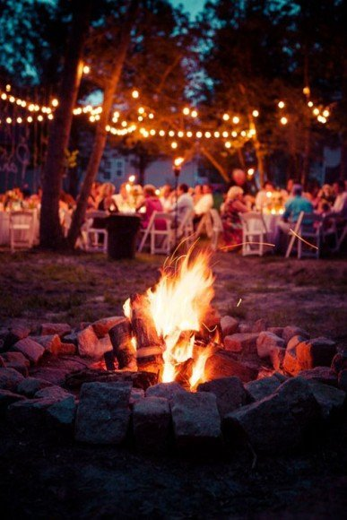 If you have an outside area setup a bonfire for guests to warm up near or make s'mores. Photo by What a Lovely Photo via