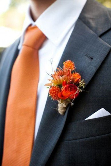 Pair an orange tie with orange and red flowers for a look that is perfectly fall.