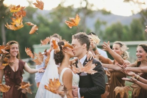 Have guests throw fall leaves instead of confetti, rose petals, or rice.  Photo  by