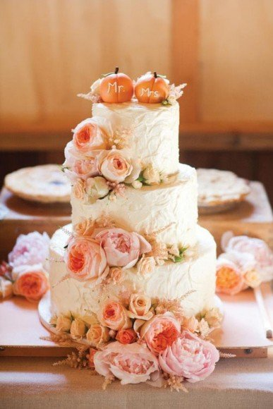 We're a big fan of using pumpkins in an muted way as well, such as these sweet mini pumpkins on top of this wedding cake.