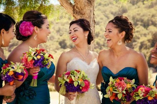 Pair bright flowers (and lipstick) with blue bridesmaid dresses