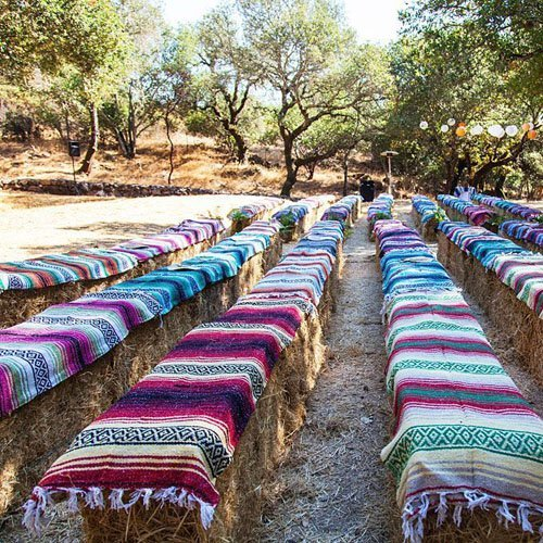 Decorate hay bales with Mexican blankets