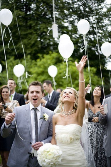 Release balloons in memory of friends and family that left too soon. Photo by Rock My Wedding