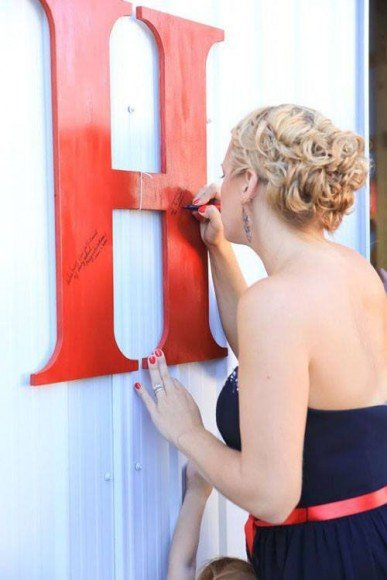 Wedding Idea: Have guests sign a large metal letter (use your first names or new last name initials) in lieu of a traditional guestbook. You can hang it on your wall later! Get more great guestbook ideas here.