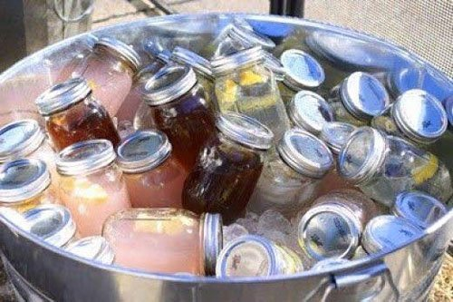 No bartender? Put pre-mixed cocktails in a mason jar and keep them on ice for an easy and stay-cool reception drink.