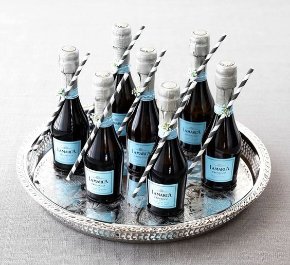 Where To Find Mini Champagne Bottle Wedding Favors Woman Getting